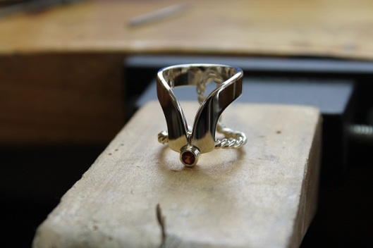 Bespoke Scarf Ring with Red Garnet, by Benjamin Black Goldsmiths