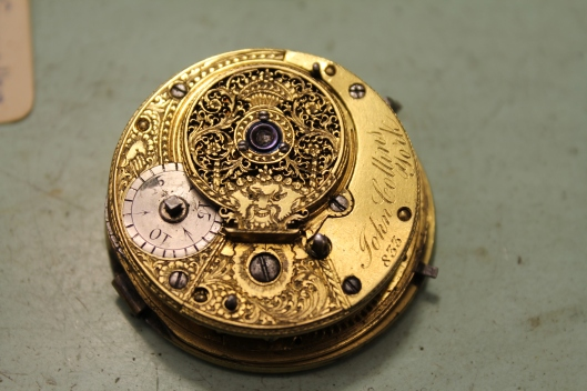 The inside/back of the pocket watch movement (verge escapement).