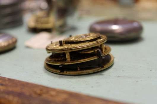 The inner workings of an antique pocket watch.