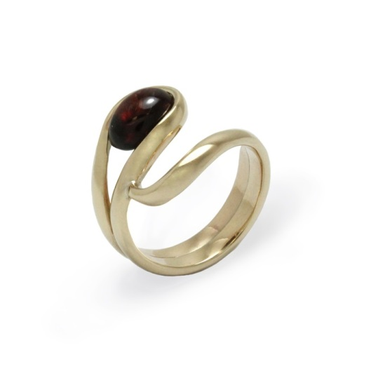 This unique bespoke ring was hand crafted in 9ct yellow gold and set with the customer's cabochon garnet stone.