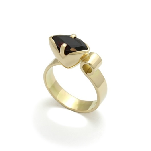 The Tulip Ring is inspired by the flower of its name, representing the emergence of new beginnings, in life, love, and nature, experienced during the blossoming season of Spring. This particular Tulip Ring is hand crafted in 18 carat yellow gold and set with a marquise cut faceted garnet.